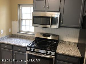 Kitchen with new granite and stainless steel appliances
