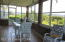 Sunroom with Tile Floor and Beautiful View
