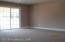 Wall to wall carpeting. Sliders to yard.