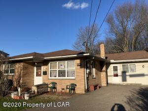 Spacious 4 bedroom 3 bath property on a large lot with an oversize garage!