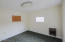 This room has a separate entrance and utilities. Could be rented out or used as an additional office space