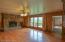 Hardwood floors and stone fireplace