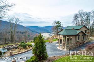 Shows views, pond, paved driveway