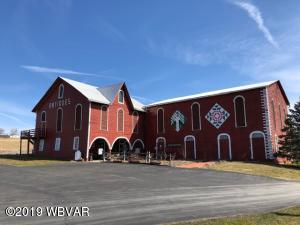 unique barn with large paved parking