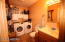 Laundry room and 1/2 bath located on first floor.