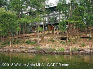 SMITH LAKE/CROOKED CREEK-Beautiful 3BR/3BA located in desirable Silverock Cove. Incredible views from each of the 3 floors. Main features floor to ceiling windows, shiplap walls, granite counters, stainless appliances, pine flooring and more. Enjoy access to walking trails, two pools, clubhouse, boat concierge and storage, boat slips and more. $349,900