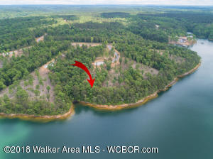 SMITH LAKE/MAIN CHANNEL-Timber Ridge Subdivision on the main channel of Ryan Creek. This lot is located just up from the dam and in one of the most desirable areas of the entire lake. Lot is almost 1 acre of property with a solid stone shoreline. Is wooded and perfect for walk out basement. Boat dock permittable through APCO. $150,000