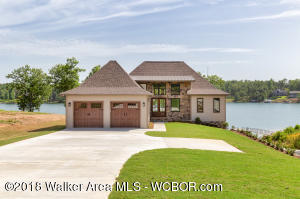 SMITH LAKE/JASPER, STUNNING New Construction, 4BR/3.5BA, popular finishes, Custom cabinets & counters, Stainless appliances, gas fire place, master on the main, walk in shower & soaking tub, full basement, bar area, walk out to the lake, 2 car garage, & a two slip boat doc. Located in a gated community w/a boat ramp, common areas & less that 20 min to town. Call for more info.