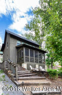 #4068 SMITH LAKE/SILVEROCK COVE- The Boxelder R Cottage- 3BR/3.5BA. Features hardwood floors and wood planked walls, wood burning FP, screen porch. Located within a gated community featuring 2 lakeside pool and clubhouse, walking trail, boat storage, boat slips,and maintenance free living.