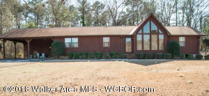 3/2 on 15 acres with a small lake. House is secluded. Beautiful view.