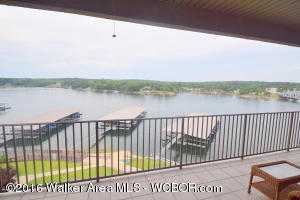 SMITH LAKE/MAIN CHANNEL-Top floor, 3BR/2BA at Duncan Bridge Resort. Views are incredible and no worry about noise from above. Huge balcony w/180 degree water views. Included is a covered boat slip in year round water. Dues are $358 per month which includes exterior insurance, garbage, sewer, grounds keeping, boat slip, parking and gated entrance. Less than one hour to Bham.