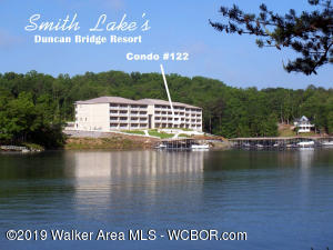 COMES FURNISHED! Smith Lake fun without all the work! Second floor condo with amazing view, covered boat slip, swimming pool and gated entrance. Many upgrades and very low utilities, taxes, and maintenance. Pets allowed. This unit is priced to sell so do not hesitate!