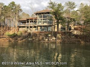 Smith Lake/ Bremen - Upscale new construction located on desirable Ryan Creek.  Walk into this spacious custom home with soaring ceilings and large store front windows and enjoy the views.  Kitchen is furnished with high end appliances and granite counter tops. Home is complete with a full kitchen and living area in the basement.  Architectural features include rustic beams, iron handrails,