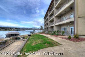 CONVENIENCE! Ground Level Corner Unit with BOAT LIFT!  Pull right up to the front door and unload your car. Walk out of your patio door to the Pool,Boat dock, or Grills.  Low Maintenance Lake living. This 3BR 2BA condo has everything to offer. Located across from Duncan Bridge Marina for convenience for all your lake needs.  Hurry this unit shouldn't last long. MUST SEE