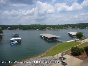 Reduced $10,000!  Smith Lake/Main Channel - Duncan Bridge Resort - Enjoy beautiful Smith Lake just minutes from all amenities and a marina.  This 3BR/2BA end unit on the 2nd floor is in a gated complex and comes with an updated MBR shower, covered boat slip, pool, parking space and beautiful view of the lake from the balcony.  Enjoy low maintenance life style on the lake.