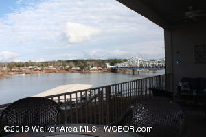 FURNISHED and ready to go!!  Gated community,  ground floor, 3BR/2BA.  Ground floor balcony with gate to walk out to lake side.  Included is a covered boat slip in year round water. Dues are $358 per month which includes exterior insurance, sewer, garbage, landscaping, boat dock, parking area and gate.   Gross rentals of over $12,000/yr.   This has been a personal use condo,  well appointed.