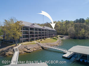 Smith Lake (Ryan Creek) Stunning and fully upgraded top floor unit at Waterford Condominiums. These units are super rare! 3BR/2BA, tall ceilings, tile and concrete flooring, custom master shower. Amazing views! Dedicated parking and boat slip. Adjacent to Trident Marina and Grille for boat svc, restaurant, and entertainment. This is truly easy and care free lake living. Less than 1 hour to Bham!