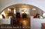 Open Living and Dining Room with Custom Archway. View from Kitchen. Original Hardwood floors.