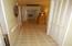 Hallway from Front Bedroom. Original Hardwood floors under Vinyl