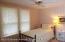 Second (Middle) Bedroom off Hallway. Original Hardwood Floors under carpet.