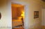 Looking into Second Bedroom standing at door of Hallway and Dining Room