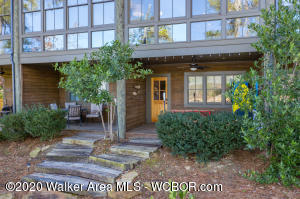 Waterfront row home featuring floor to ceiling windows Open floor plan,shiplap walls  & wide plank floors.  Kitchen w/ granite c'tops & island overlooks dining/family rm & lake!  Master ste w/ lake views + ensuite guest rm up. Main lvl BR & full bath. Walk out basement offers multiple options w/ a bedroom, full bath, & bonus rm. 2 salt water pools, clubhouse, dry boat storage/concierge A MUST SEE!