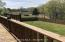 back deck overlooking fenced in back yard
