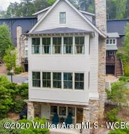 MAINTENANCE FREE LIVING ON SMITH LAKE IN THE GATED  SILVEROCK COVE!  This gorgeous waterfront home offers an open floor plan & is filled with natural light. Features include white washed shiplap walls, pine hardwood floors, granite c'tops, stainless steel appliances, 2 fireplaces & wonderful lake views!  A lighted boardwalk surrounds the community with 2 salt water pools, clubhouse, & boat valet.