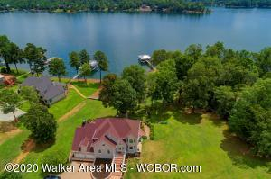 You've earned a time to relax and enjoy your labors and this Fantastic Smart Home welcomes you. Lake living at it's best with over 460 feet of shoreline and new double slip boat house with swim deck is just the beginning. This Smart home has beautiful architectural details through out. Hardwoods,Granite, Stainless all the finishes you would expect. The large windows offer lake views in almost ever