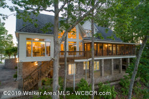 SMITH LAKE/ROCK CREEK-Unique 5BR/3.5BA waterfront home. A stately custom built home sitting on a spectacular  lot. This property has waterfront on both the East and West sides giving you gorgeous views from every direction. The dock is situated on the cove side giving you total protection from wind and water traffic. The main channel side is completely open to capture those wonderful sunsets. The home has wide open spaces and approx 5000 square feet of living space. Super gentle slope to the water and rock shoreline is the best you can buy. Dock is all aluminum and top of the line from Flotation Systems. Other amenities include:  Whole house 35KW Kohler stand by generator, Dual 50 gallon inline electric water heaters with optional on/off switch on second, Two complete Trane heating/AC systems recently replaced, New stainless steel kitchen appliances recently installed, New tile in kitchen and lower level bath, New hardwood flooring throughout main level, Central vac, Intercom, Surround sound, New gas logs, Lawn sprinkler system sourced from the lake and Dual septic system. Must see this amazing home in person to appreciate.