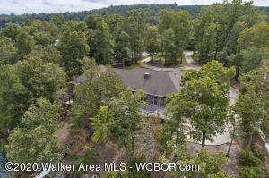 SMITH LAKE/ARLEY, 4BR/3.5BA, Certified energy star, Master on the main, gas fire place, custom cabinets, undercounter refrigerator in the island, double oven & electric stove, formal dinning, sun room, basement w/est 1500' of work space & dual his and her man caves, all sitting on two of the best waterfront lots totaling over 220' wf. Floatation systems dock, landscaped, irrigation, & home gen.