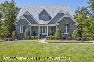 Smith Lake/Arley Custom designed 4BR/4.5BA Located Across from Bankhead Nation Forest.Enjoy the drive in through the wooded entrance to this Country Setting Lake Home. Finished basement with kitchen. Home was built for entertainment. On the way to the dock enjoy a landscaped yard with several entertainment areas. Easy walk to the water with single boat slip. Enjoy this Peaceful Retreat on the Lake