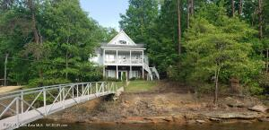 Smith Lake home on Bear Branch. No steps to the water. Aluminum boat dock with lift. Deep, year round water in a NO wake zone. 4 BR 3 baths. Kitchen on main level, and kitchen in lower level.  Sold Furnished!Probably , the easiest lake access you will find on Smith Lake!Boat is also available for purchase.2020 Yamaha 195FSH, inboard, jet drive, 1.6L turbo $35,000.00