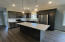 Kitchen with Quartz counters and tiled backsplash