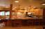Iooking into kitchen, breakfast bar