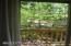 Abundant trees shade studio.