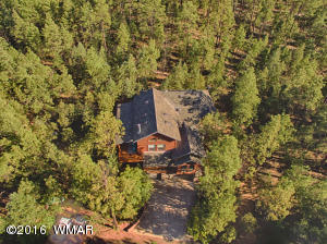 5 spacious acres of incredible pines!