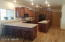 Kitchen with custom cabinets and solid surface counter tops