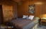 Newer queen mattress & large armoire in larger bedroom.