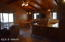Bar stools for extra seating. T & G vaulted ceilings throughout.