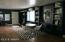 Large play/media room and door to garage