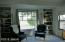 Master bedroom bookshelves and picture window