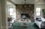 Living room with rock wall wood burning stove insert