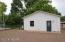 Separate living quarters in back yard.