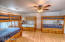Upstairs Master bedroom as bunk room. Beds convey with trundles