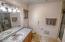 Large master bath and separate vanities. Walk-in closet