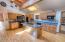 Spacious kitchen with bar seating & hardwood floors.