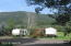 RV spaces and view of meadow, mountains.