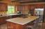 Kitchen has a gas cook top, electric oven and generous built-in microwave.