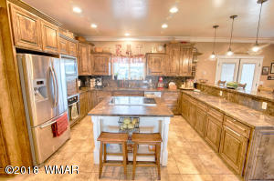 Gorgeous Open Kitchen with Custom Cabinets, Granite Countertop and Island, Stainless appliances, and built in dual level breakfast bar.